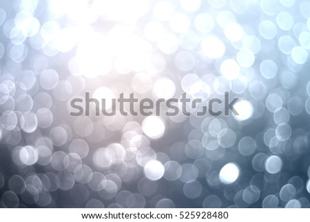 Glitter winter background. Snow glitter. Silver blue festive texture.