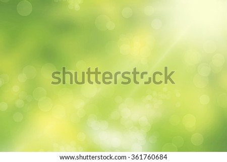 Glittering bokeh lights on a green background - stock photo
