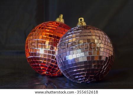 Glittering Christmas balls against a black background - stock photo