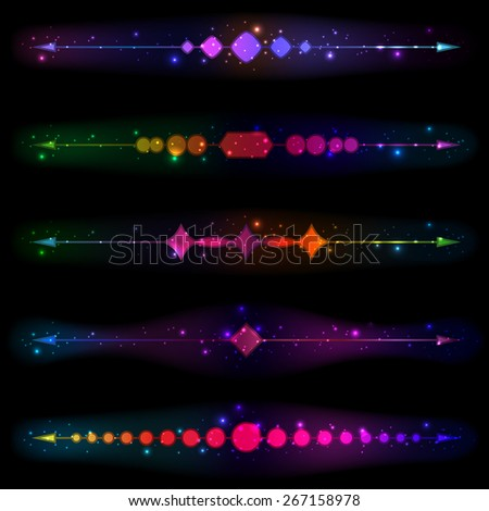 Glittering design elements and page decoration on a black background. - stock photo