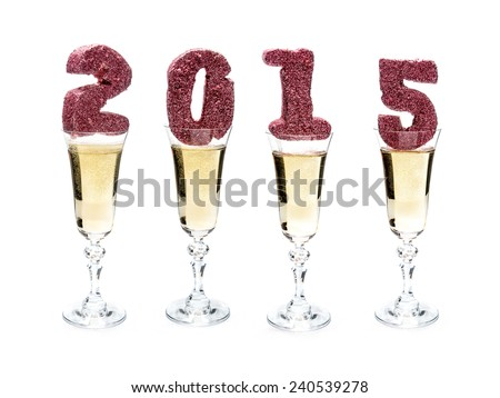 Glittering 2015 New Year digits placed in four champagne glasses shot on white - stock photo