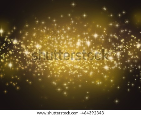 Glittering stars on a gold bokeh background. Night sky with stars background / texture