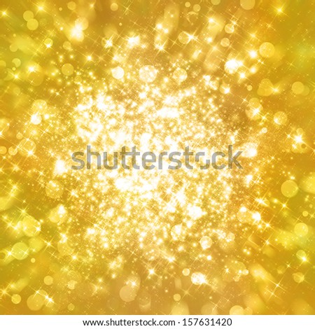 Glittering stars on golden glittering background.Abstract gold twinkle backdrop. - stock photo