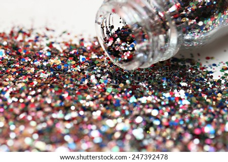 Glitters, Close up view of bottle full of colorful glitters  - stock photo