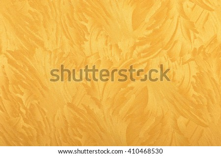 Glittery and textured golden metallic paper background - stock photo
