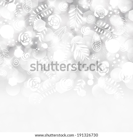 Glittery lights silver abstract holiday background.