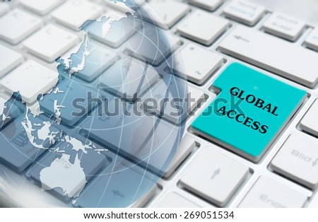 Global access enter key and glass globe over white computer keyboard  - stock photo