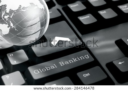 Global banking  button on computer keyboard with glass globe. - stock photo