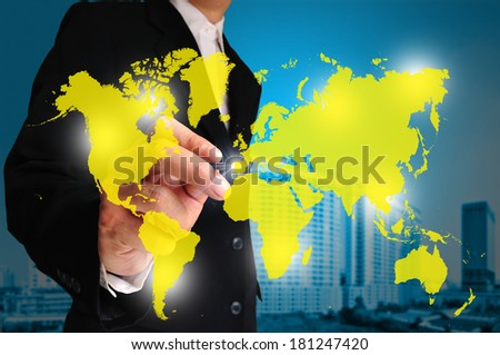 Global business concept with businessman that draws a world map.  Element of this image furnished by NASA. - stock photo