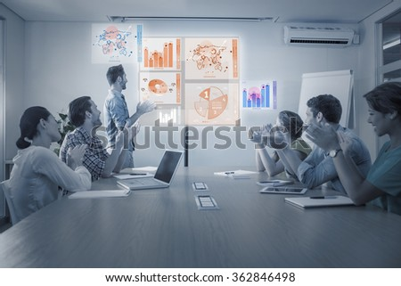 Global business interface against attentive business team applausing after a conference - stock photo