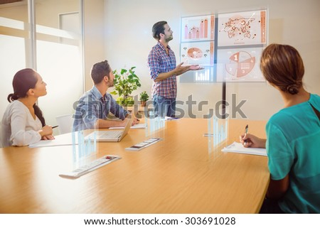 Global business interface against creative businessman making a presentation - stock photo