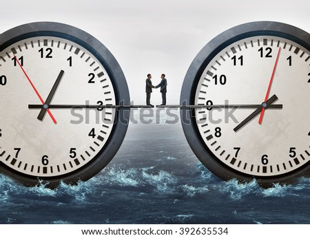 Global business meeting handshake as businessmen from across the ocean coming together to make a deal in a business agreement or diplomacy success joining in unity on the minute hand of giant clocks. - stock photo