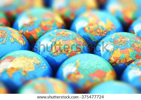 Global communication, environment protection, ecology and nature saving business technology concept: macro view of the group of small Earth globe spheres with world maps with selective focus effect