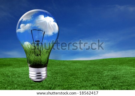 Global Concept of Green Energy Solutions With Light bulb and Planet on Bright Landscape