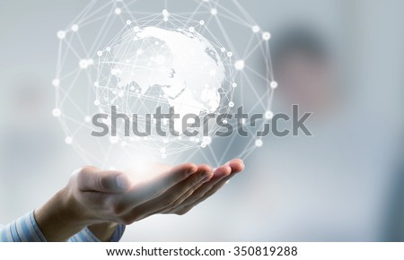 Global connection concept with digital planet in hands - stock photo