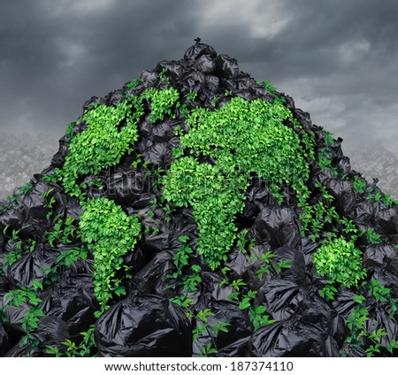 Global garbage concept with a mountain of black plastic trash bags in a landfill with a vine shaped as the planet growing through the rubbish as a metaphor for revival and hope for the environment. - stock photo