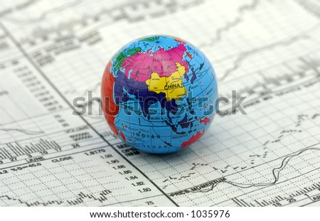 Global Markets Concept - Stock Charts and a Globe - stock photo