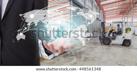 Global network coverage world map on hand of businessman ,Distribution of goods in warehouse process for Logistic Import Export background (Elements of this image furnished by NASA) - stock photo