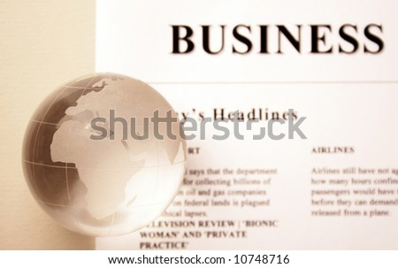 global news. newspaper and globe - stock photo