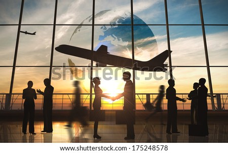 Global Team Business shake hand with airplane silhouettes - stock photo