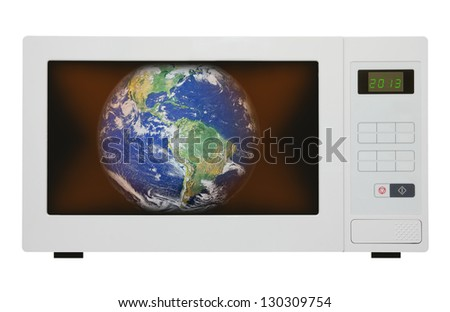 Global warming concept - earth in microwave. Elements of this image furnished by NASA - stock photo