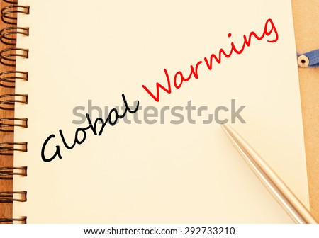 Global warming concept on book  - stock photo