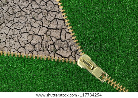 Global Warming. Zipper with cracked earth and grass - stock photo