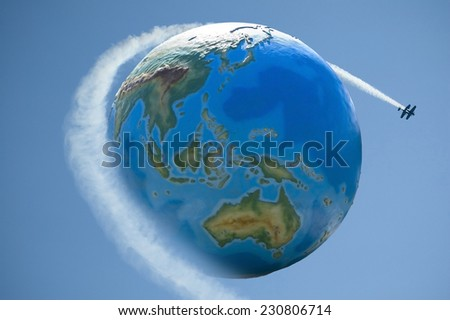 Globalization concept - air transport. Airplanes flying over Earth globe. - stock photo