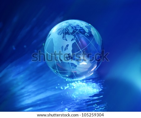 globe against fiber optic background