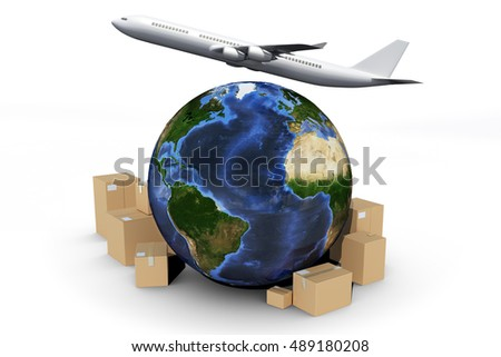 Globe and cardboard boxes against graphic airplane