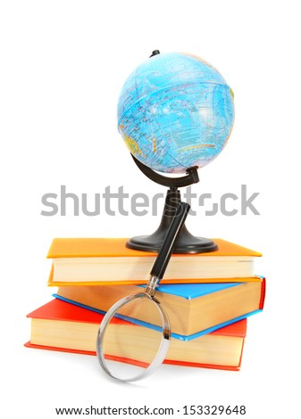 Globe and magnifier with books. On a white background. - stock photo