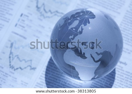Globe and newspaper - stock photo