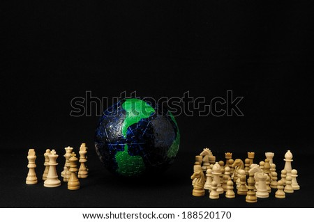 Globe And White Chess on a Black Background
