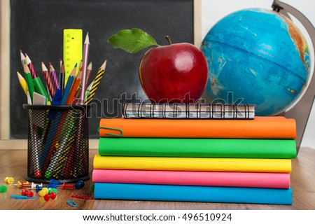 Globe, books stack and pencils. Schoolchild and student studies accessories. Back to school concept.