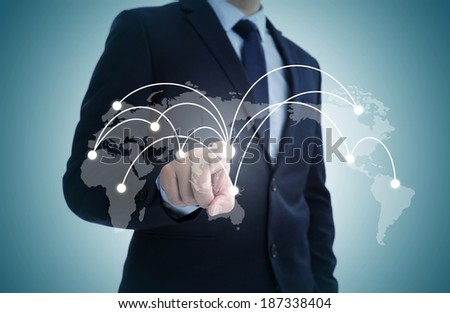 Globe business symbols on a touch screen interface - stock photo