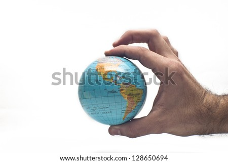 Globe ,earth in human hand, isolated on white