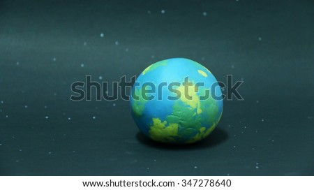 Globe ,earth made from clay on blue background, bank space for text : concept for clay - stock photo