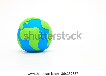Globe ,earth made from clay on white background with copy space. Concept Save green planet. Earth day holiday concept