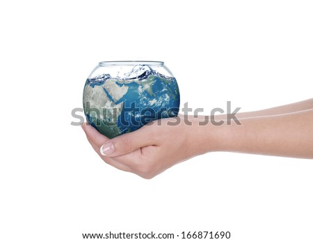 Globe in human hand against blue sky. Environmental protection concept.  - stock photo