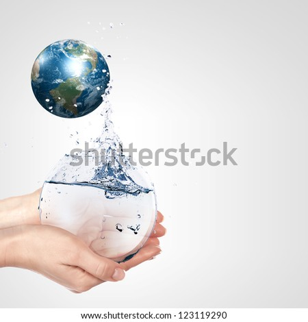 Globe in human hand against blue sky. Environmental protection concept. Elements of this image furnished by NASA - stock photo