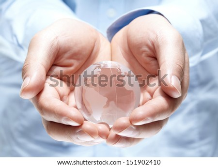 Globe in human hand  isolated on white background - stock photo