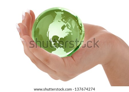 Globe in womans hand concept for protecting the earth and environmental conservation - stock photo