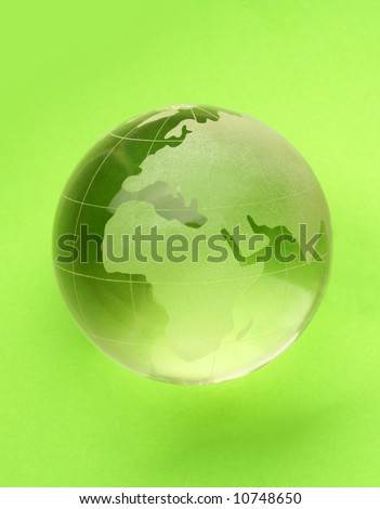 globe isolated on green background with reflection - stock photo