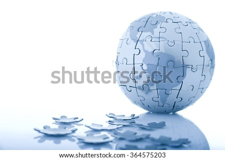 Globe jigsaw puzzle while some parts dropped. Isolated on white background with drop shadow.