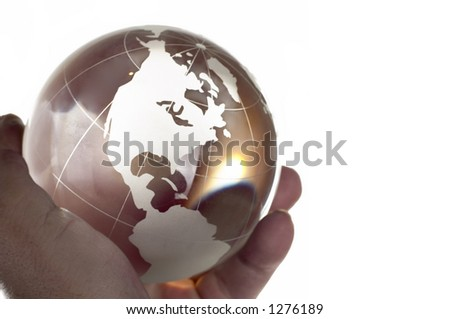 Globe made of glass in hand