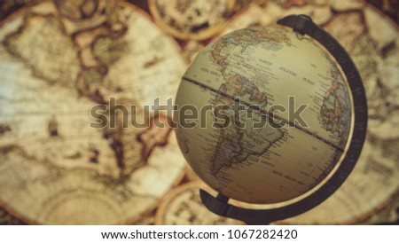 Globe model old world map stock photo royalty free 1067282420 globe model and old world map gumiabroncs Image collections