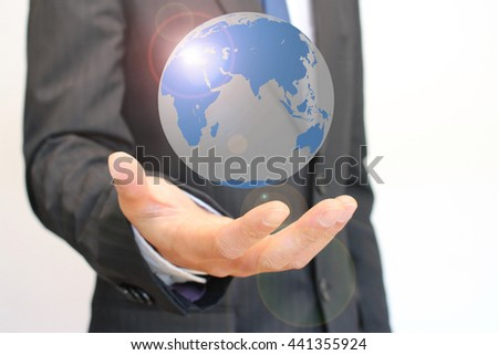 Globe on a hand of a businessman