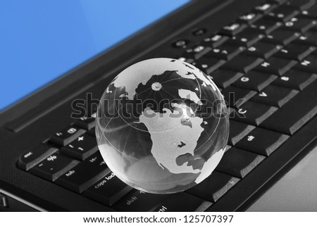 Globe on a keyboard laptop