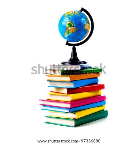 Globe on books isolated over white background - stock photo