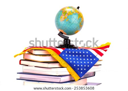Globe on books with American flag isolated over white background - stock photo